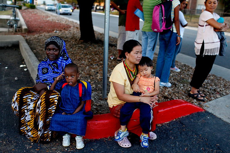 Two-families-at-the-bus-stop