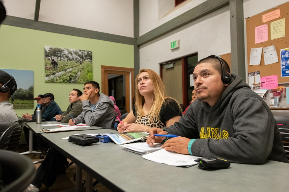 A group of students listen intently to a lecture on soil conservation. Posted to accompany GCIR's webinar, Economic Security for Immigrants: Innovative Workforce Approaches.