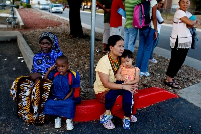 Program Image: Two families waiting at the bus stop