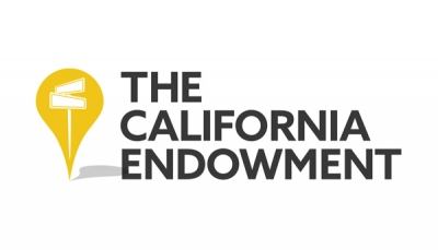 The California Endowment logo, which features their logo in bolded black, capital letters on the right, with a map marker in yellow on the left, with two street signs within the marker.