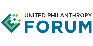 The United Philanthropy Forum logo, which features the first two letters of their name in black capital letters above 'Forum' in much larger blue letters, all to the right of a blue-green square, one quarter of which is in pieces.