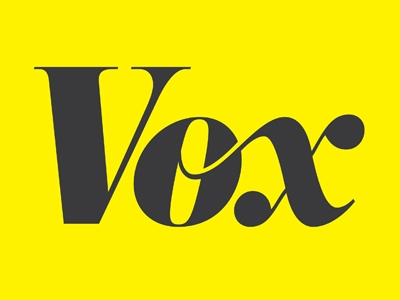 Vox's logo, which features their name in black script on a rectangular yellow background.