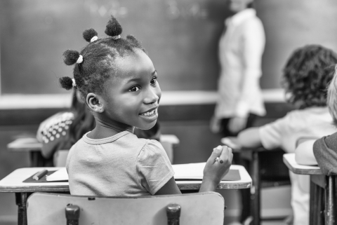 African girl turning in her chair at primary school. From GCIR's Black History Month: Diversity and Strength of the Black Immigrant Community in the U.S. webinar.